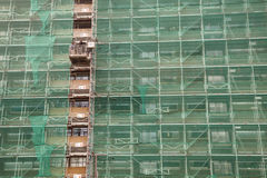 Scaffolding and green drapes for protection Stock Photography