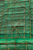 Scaffolding and green netting abstract backgground. Construction scaffolding and green debris netting abstract background Stock Image