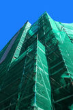 Scaffolding with green safety net Royalty Free Stock Images