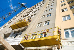 Scaffolding hanging on an unfinished building Stock Photography