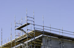 Scaffolding. On a house in progress stock images