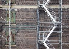 Scaffolding ladder against brick wall Stock Photography
