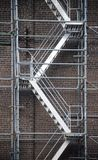 Scaffolding ladder against brick wall Stock Photos