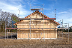 Scaffolding at a new wooden house Royalty Free Stock Image