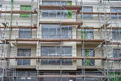 Scaffolding on a newly built house royalty free stock photo