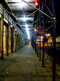 Scaffolding at night. Scaffolding on a street at night Stock Photos