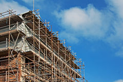 Scaffolding on old building under renovation Stock Photography