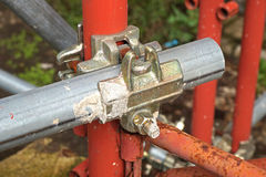 Scaffolding pipe clamp and parts, An important part of building strength to scaffold. Stock Photo