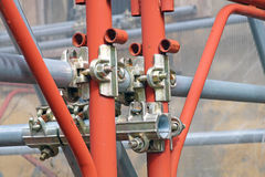 Scaffolding pipe clamp and parts, An important part of building strength to scaffold. Royalty Free Stock Photo