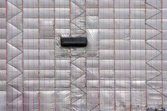 Scaffolding with plastic tarpaulin Royalty Free Stock Photos