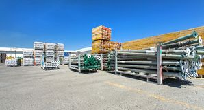 Scaffolding poles and brackets stacked in a yard. a blood test stock photo