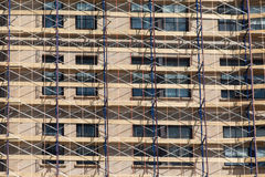 Scaffolding on a renovated building, a net convering the buildin Royalty Free Stock Photography