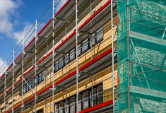 Scaffolding for a renovation of an old house Royalty Free Stock Photo