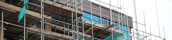 Scaffolding on a renovation site. Site under construction stock image