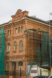 Scaffolding for restoration of an old building Stock Photo