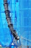 Scaffolding with rubbish waste chute. Scaffolding with a rubbish waste chute Royalty Free Stock Images
