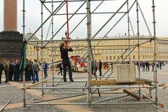 Scaffolding Saint-Petersburg, Russia. September 6, 2015 - Saint-Petersburg, Russia.  Construction worker without uniform making scaffolding from metal poles Royalty Free Stock Image