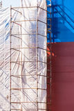 Scaffolding on a ship. Scaffolding on boat. Ship under construction. Renovation work with protection sheet stock photo