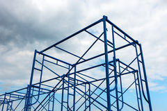 Scaffolding site erection on cloudy background. Scaffolding site erection on cloudy background, Construction site royalty free stock photos