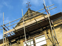 Scaffolding on stone building. Scaffolding on renovation of existing stone building Royalty Free Stock Photography