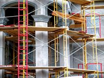 Scaffolding for stucco cement structure. Ladder and scaffold with boards for stucco cement building Royalty Free Stock Photo