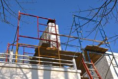 Scaffolding surround a chimney under repair royalty free stock images