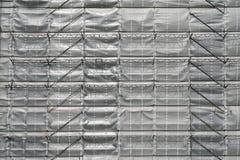 Scaffolding and tarpaulin Stock Photo