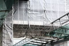Scaffolding with tarpaulins stock photos