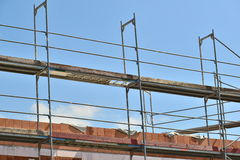 Scaffolding. Top of a scaffolding on the site of a newly built building - for construction or progress concepts stock photos