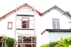 Scaffolding tower painting repairs old house, Netherlands Stock Photo