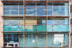 Scaffolding used as the temporary structure to support platform, form work and structure at the construction site.Repair of a larg Royalty Free Stock Images