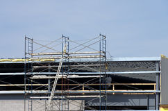 Scaffolding. Used by construction workers while working on an new industrial building Stock Photography