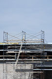 Scaffolding. Used by construction workers while working on an new industrial building Royalty Free Stock Photo