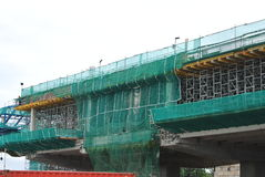 Scaffolding used to support a platform for construction workers to work Stock Image