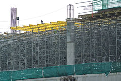 Scaffolding used to support a platform for construction workers to work Stock Photo