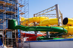 Scaffolding and water attraction pipes. Photo taken at the construction of the water park `Limpopo` in the city of Orenburg. Russia. 04/21/2012 Stock Photos