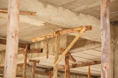 Scaffolding wood for small building construction stock image