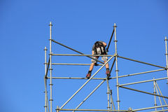 Scaffolding workers. Building a new construction, pure teamwork stock photos