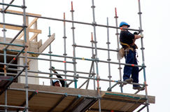 Scaffolding workers at work Royalty Free Stock Image