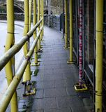Scaffolding, with yellow cladding. stock images