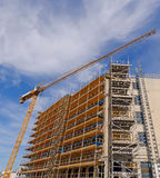 Scaffolds and crane Stock Photography