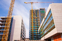 Scaffolds and cranes at construction site Royalty Free Stock Images