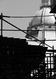 Scaffolds with a dome on the background, black and white. View of some scaffolds with a baroque dome on the background, palermo, sicily, portrait cut Royalty Free Stock Photos