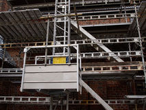 Scaffolds on a house building under renovations Stock Photo