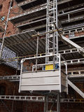 Scaffolds on a house building under renovations Stock Image