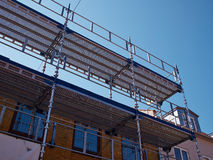 Scaffolds on a house building under renovations Royalty Free Stock Image
