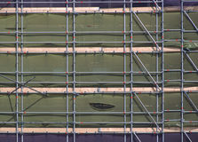 Scaffolds. And protection fabric at a construction site royalty free stock photos