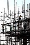 The scaffolds and workers Stock Photo