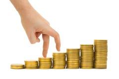 Scala dei soldi e della mano Fotografie Stock