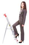 Scala rampicante della donna di affari Fotografia Stock